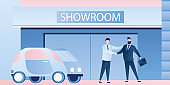 Businessmen shake hands near the show room building. Purchase or rental of vehicle