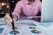Bookkeeper accounting Concepts, Male  pen , and computer laptop to working financial and budget, inspector accountant concept.
