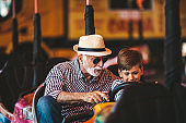 Grandfather and grandson amusement park fun