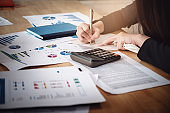 Bookkeeper accounting Concepts, FeMale use pen , calculator and notebook to working financial and budget, inspector accountant concept.