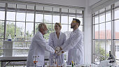 Scientist work with science equipment in laboratory. Scientific research concept.