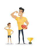 Father and Adorable Son with Basketball Soccer and Cup.