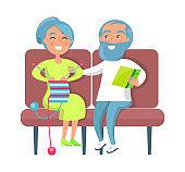 Senior Lady Knitting and Gentleman Reading on Sofa