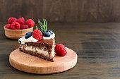 Homemade chocolate cake with raspberries and blueberries.