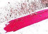 Lipstick smudge, mascara stroke and crushed eyeshadow isolated on white background