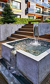 Decorative water fountain at Modern complex of apartment residential buildings