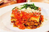 Lasagna bolognese plate, traditional recipe with tomato sauce, cheese and meat