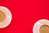 Hot aromatic coffee on red background, flatlay