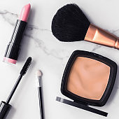 Make-up and cosmetics flatlay on marble