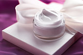 Beauty face cream skin moisturizer, luxury spa cosmetic and natural clean skincare product and holiday gift on purple silk