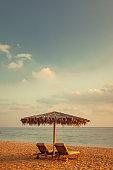 sun chairs and umbrella