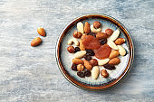 Nuts, raisins and apricots on rustic wooden background. Concept for healthy snack. Top view. Copy space.