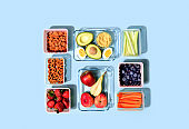 Lunch boxes with fresh raw food, healthy food concept