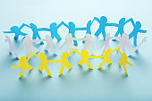 Paper chain people on blue background