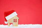 Santa hat with house model on red background