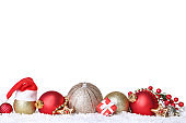 Christmas ornaments with snow and gingerbread cookies on white background