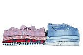 Stack of folded clothes isolated on white background