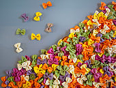 Multi-colored pasta in the shape of butterflies loose