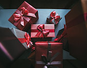 Gift boxes. Presents in craft and colored paper decorated with red ribbon bows.