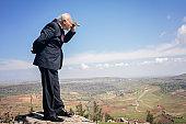 Senior Businessman Looking Through Binoculars