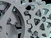 A cluster of interlocking metal gears. 3D
