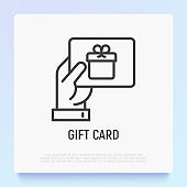 Hand with gift card. Certificate for purchase, discount, coupon. Thin line icon. Modern vector illustration of present for Christmas, Valentine day or birthday.