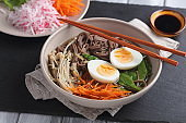 Japanese soup with Enoki mushrooms, soba noodles, and vegetables