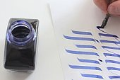 Calligraphy study, italian cursive, letters c, d, e. Handwriting with flat nib.