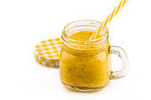 Smoothie with tropical fruits: mango, banana, avocado, chia seeds in a glass jar. Isolated on white background