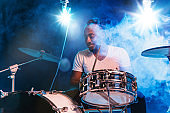Young african-american jazz musician playing drums