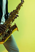 Young african-american jazz musician playing the saxophone