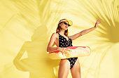 Beautiful girl isolated on yellow studio background