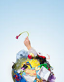 A globe of the earth with trash over white background, the concept of ecology problem