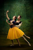 Young ballet dancers as a Snow White's characters in forest