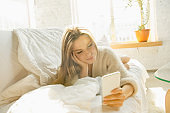 Beautiful young woman relaxing at home, comfort and calm