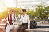 Happy business people enjoying coffee break