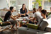 Group of young caucasian office workers have creative meeting to discuss new ideas