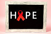 Aids Awareness Sign Red Ribbon. World Aids Day concept.