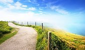 View with a footpath from Cap Blanc Nez on a sunny day with morning fog