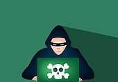 """Hacker using a laptop with """"skull and crossbones"""" symbol on it, stock - Illustration"""