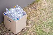 plastic bottles in brown recycle garbage box