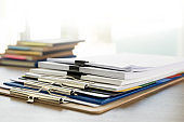 man report stack paper folder close up stacking of office working document with paper legal paperwork on top