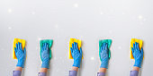 Commercial cleaning company. Employee hands in blue rubber protective glove. General or regular cleanup.