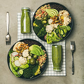 Flat-lay of healthy dinner with superbowls and smoothies, square crop