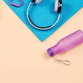 Fitness equipment. Woman workout accessories and clothes flat lay. Top view, fitness background