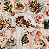 Flat-lay of people eating and drinking rose wine, square crop