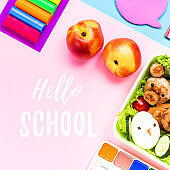 School supplies, colorful stationery, backpack and lunchbox with funny food for kids . Back to school concept lay out