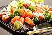 Sushi and Sashimi on black background
