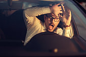 Frightened businessman having a car accident