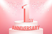 One years anniversary celebration on pink background.